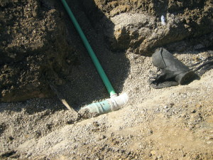 Sewer service tying into main sewer line for the  housing subdivision