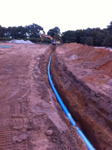 Laying the water line for 57 lot subdivision