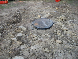 Sewer manhole after backfilling